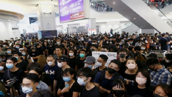 Hong Kong airport halts check-ins as UN urges restraint over protests