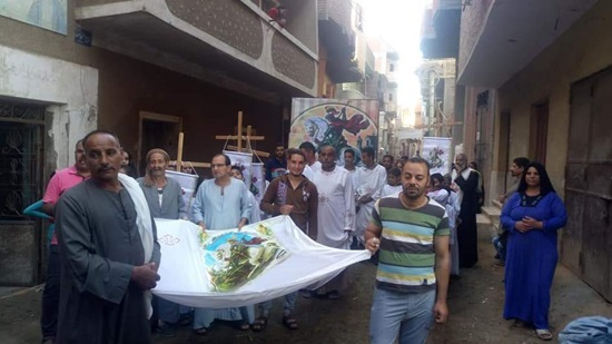 Copts in Minya celebrate St. George s feast  by a street procession