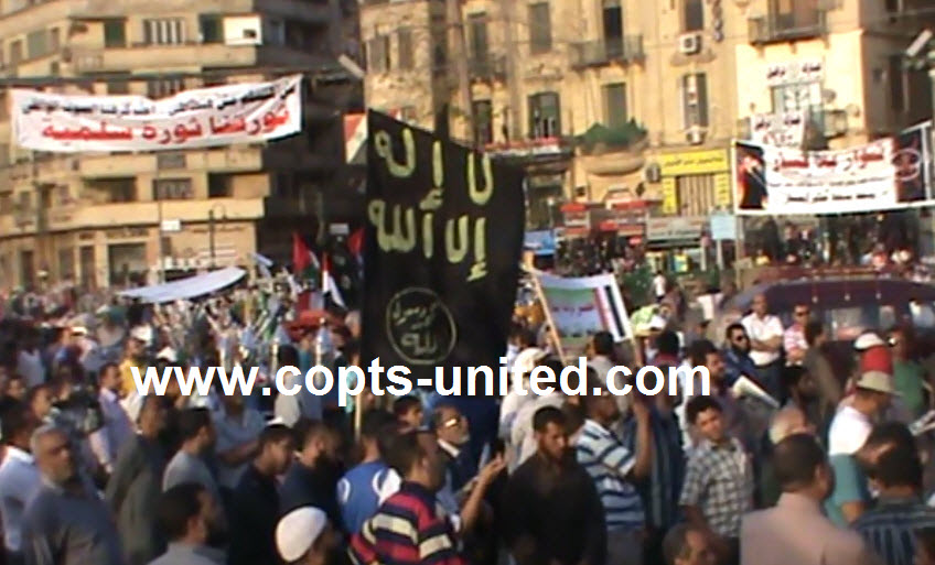 Abu Ismail supports carry the flag of al-Qaeda in Tahrir square