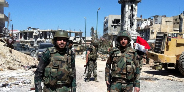 Syrian army battles Islamic State for third day near key road